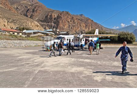 JOMSOM, NEPAL - OCTOBER 05, 2008: Passengers enter to the plane of Sita airlines at the Jomsom airport, Annapurna region, Nepal