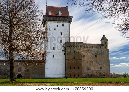 Narva, Estonia - May 4, 2016: Herman Castle on the banks of the river opposite the Ivangorod fortress. Built by the Swedes in the 14th century.