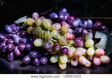 Red And White Grapes On The Table