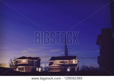 Purple Sky Behind two Houses at Night.