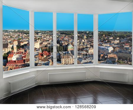 modern windows with view of Lviv bird's-eye view