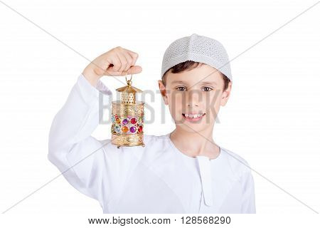 Happy Ramadan - Young boy smiling and holding Ramadan lantern
