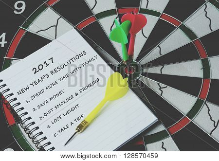 2017 New Year's Resolutions On Notepad With Darts On Bulls Eye, Retro Style