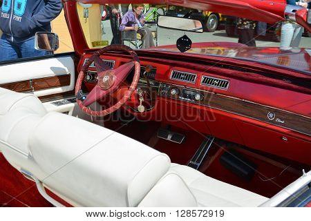 CLUJ-NAPOCA ROMANIA - APRIL 16 2016: Cadillac Eldorado convertible 1976 cockpit red dashboard white leather seats on display at the 2016 Retro Spring Parade.