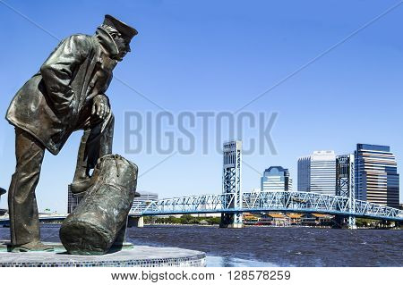 Jacksonville Florida skyline and sailor sculpture along the St Johns River