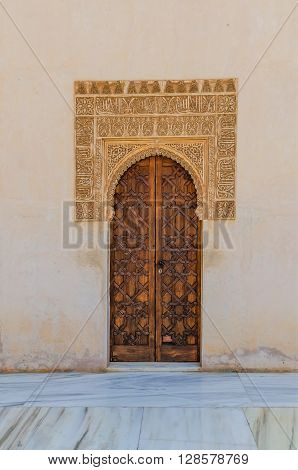 Little door with arabic decoration in comares court. Alhambra Granada Andalusia Spain