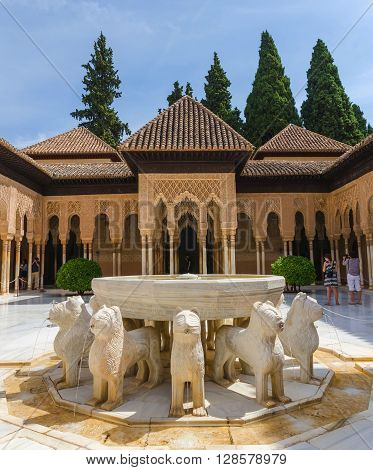 GRANADA SPAIN - SEPTEMBER 9: groups of tourists taking pictures in Patio de los leones. Alhambra of Granada Spain. Alhambra of Granada is one of the most known and visited monuments in Spain.