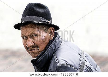 Banos De Agua Santa - 29 November 2014: Portrait Of An Old Indigenous Man On The Streets Of Banos De Agua Santa South America In Banos De Agua Santa On November 29 2014