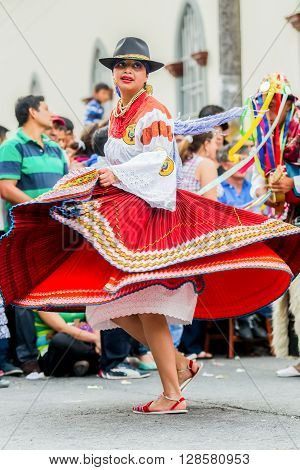 Banos De Agua Santa - 29 November, 2014: Proud Indigenous Woman Wearing A Traditional Folk Costume From Ecuador Dancing On The Street South America In Banos De Agua Santa On November 29, 2014