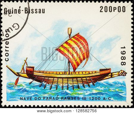 MOSCOW RUSSIA - MAY 01 2016: A stamp printed in Guinea-Bissau shows image of ancient Egyptian ship times Pharaoh Ramses III (1200 B.C.) series
