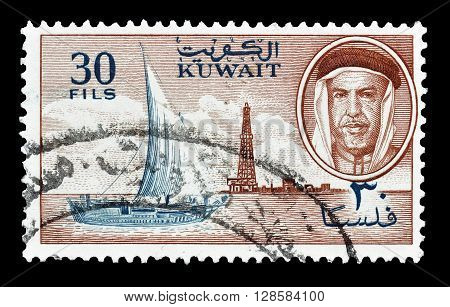KUWAIT - CIRCA 1960 : Cancelled postage stamp printed by Kuwait, that shows Dhow, derrick and sheik.