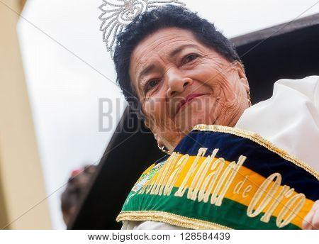 Banos De Agua Santa - 29 November 2014: Golden Queen of the Banos De Agua Santa Riding In A Carriage Welcoming The World South America In Banos De Agua Santa On November 29 2014