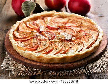 Fruit baking apple pie on wooden table