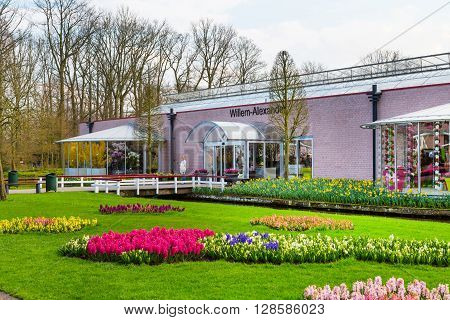 Lisse, Netherlands - April 4, 2016: Pavillion Willem Alexander and flower blossom in dutch park spring garden Keukenhof, Lisse, Netherlands