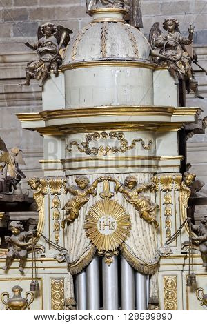 Jaen Spain - may 2016 2: Detail of the top turret of the box of the organ with the musical angels is on the choir in the side of the Epistle of the Cathedraltake in Jaen Spain