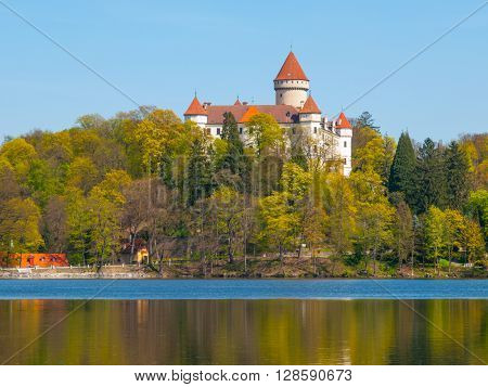 Chateau Konopiste with typical rounded tower reflecting in the water, Benesov, Czech Republic ** Note: Soft Focus at 100%, best at smaller sizes