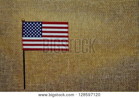 American Flag set on rustic tan mesh background, backdrop.  Celebrate Holidays, Memorial Day, Veteran's Day, Labor Day, 4th of July.