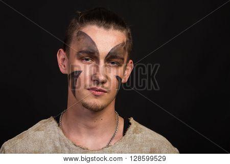 Actor in makeup a poor man in a suit poster