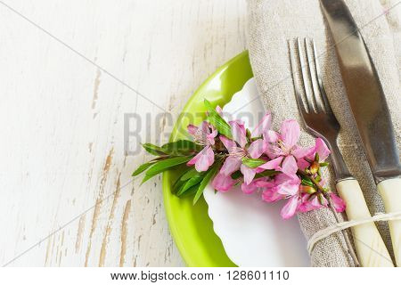Spring table setting closeup Decorated branch of flowering almonds