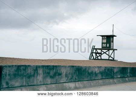 Stunning isolated beach scene, featuring a lifeguard tower and sand dunes.