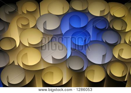 A Colourful Abstract Of Paper Twirls Blue Yellow Brown