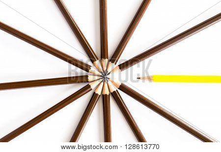 brown wooden pencil arrange as circular with one of different pencil try to close the gap on the white background un-matching concept