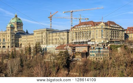 Bern, Switzerland - 29 December, 2015: view from Kornhausbruecke bridge with the Federal Palace of Switzerland and Hotel Bellevue buildings. Bern is the capital of Switzerland and is also the capital of the Swiss canton of Bern.
