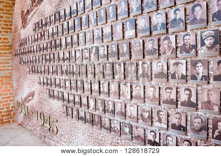 NIZHNY NOVGOROD, RUSSIA - AUGUST 28, 2015: Mosaic from the old front-line of photos on the Kremlin wall.