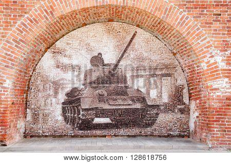 NIZHNY NOVGOROD, RUSSIA - AUGUST 28, 2015: The legendary T-34 tank. Mosaic of old frontline photos.