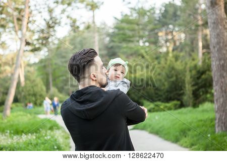 Father And His Son On A Walk In The Park