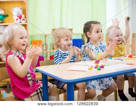 kids group learning arts and crafts in day care centre