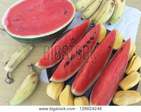 watermelon sliced bananas on a plate dzhetfrut