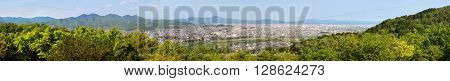 Ultra wide panorama of Arashiyama and Kyoto city in Japan and the surrounding landscape and mountains
