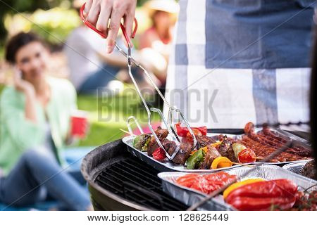 Preparing food for a vegetarian during barbecue