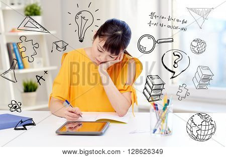 people, education, high school and learning concept - bored asian young woman student in glasses with tablet pc computer, book and notepad writing at home over doodles