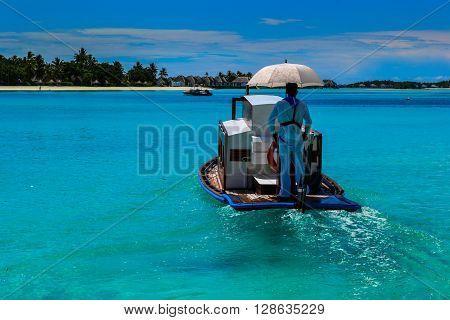 Maldives island - sandy beach and indian ocean, boat