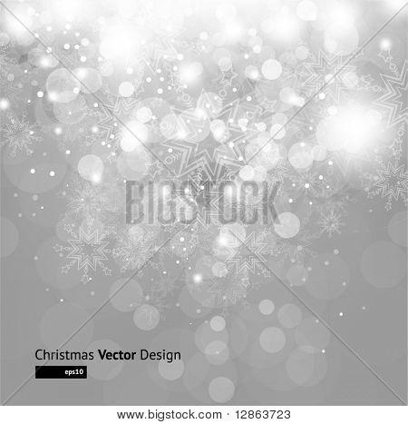 Luce d'argento astratto sfondo natalizio con fiocchi di neve bianche