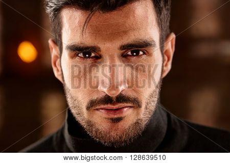 Closeup photo of charming young man looking at camera.