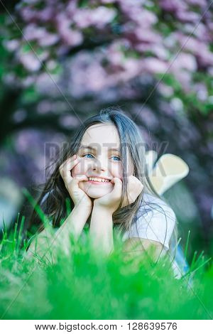 Little Girl On Grass In Bloom