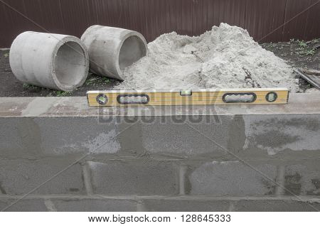 new beautyfull yellow level for building on the cinderblocks background. Process of building.