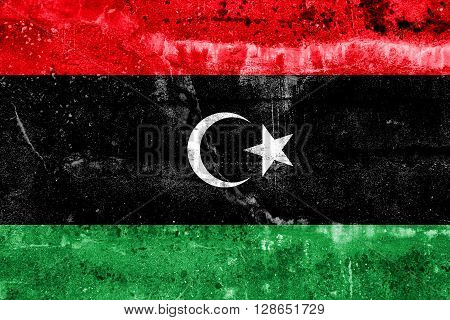 Libya Flag painted on grunge wall. Vintage and old look.