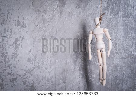 Wooden Figure Of Human In A Hangmans Loop
