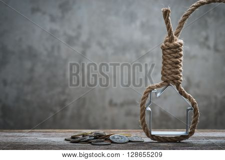 Hangman's Noose With House And Money On Brown Wooden Surface