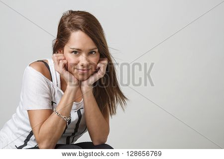 young twenty year old woman holding her head into her hand
