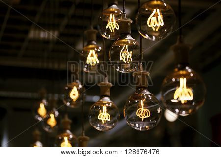 Group of lamps with interesting shape of tungsten filament.