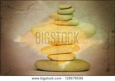 Yellow grunge effect applied to stacked stones