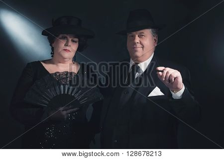 Vintage Well Dressed 1940S Couple With Fan And Cigar. Classic Portrait.