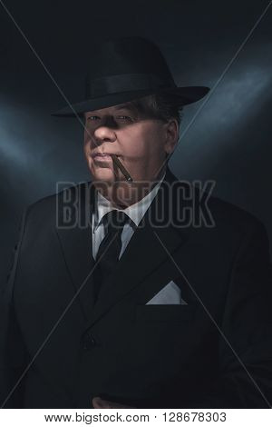 Retro 1930S Gangster Smoking Cigar. Classic Studio Portrait.
