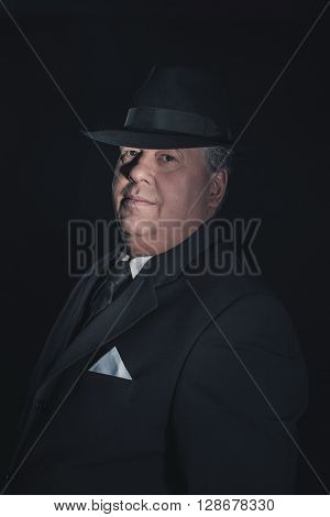 Retro 1930S Gangster Wearing Hat. Classic Studio Portrait.