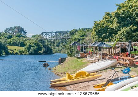 KNYSNA SOUTH AFRICA - MARCH 3 2016: A resort next to the Goukamma River with a railway bridge on the historic Outeniqua Choo-Choo railway in the back